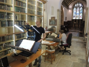 Matthew uses the portable book cradle borrowed from the Oxford Conservation Consortium to photograph early Library records at St Cross church.