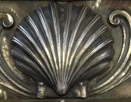a silver sea shell