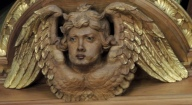 an angel (or cherub) in wood