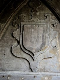 Shield of John de Balliol, founder of the College, on wooden gates (front quad, chapel passage)