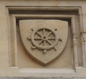 Catherine Wheel, on the inner side of the tower over the front gate (front quad, main entrance)