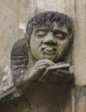 One of the figures decorating the new Library/Old Hall (front quad, west side)