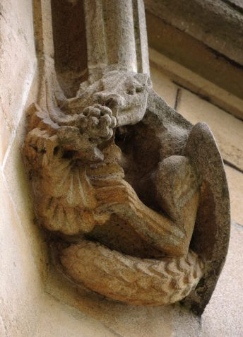 A little dragon eats grapes above the archway on the quad side of the porter's lodge (front quad, st 5)